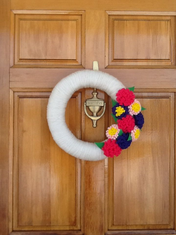 Wreath with felt flowers for spring