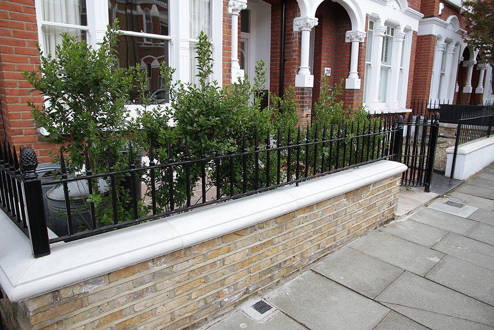 Stylish cast iron black half railings with yellow brick ...