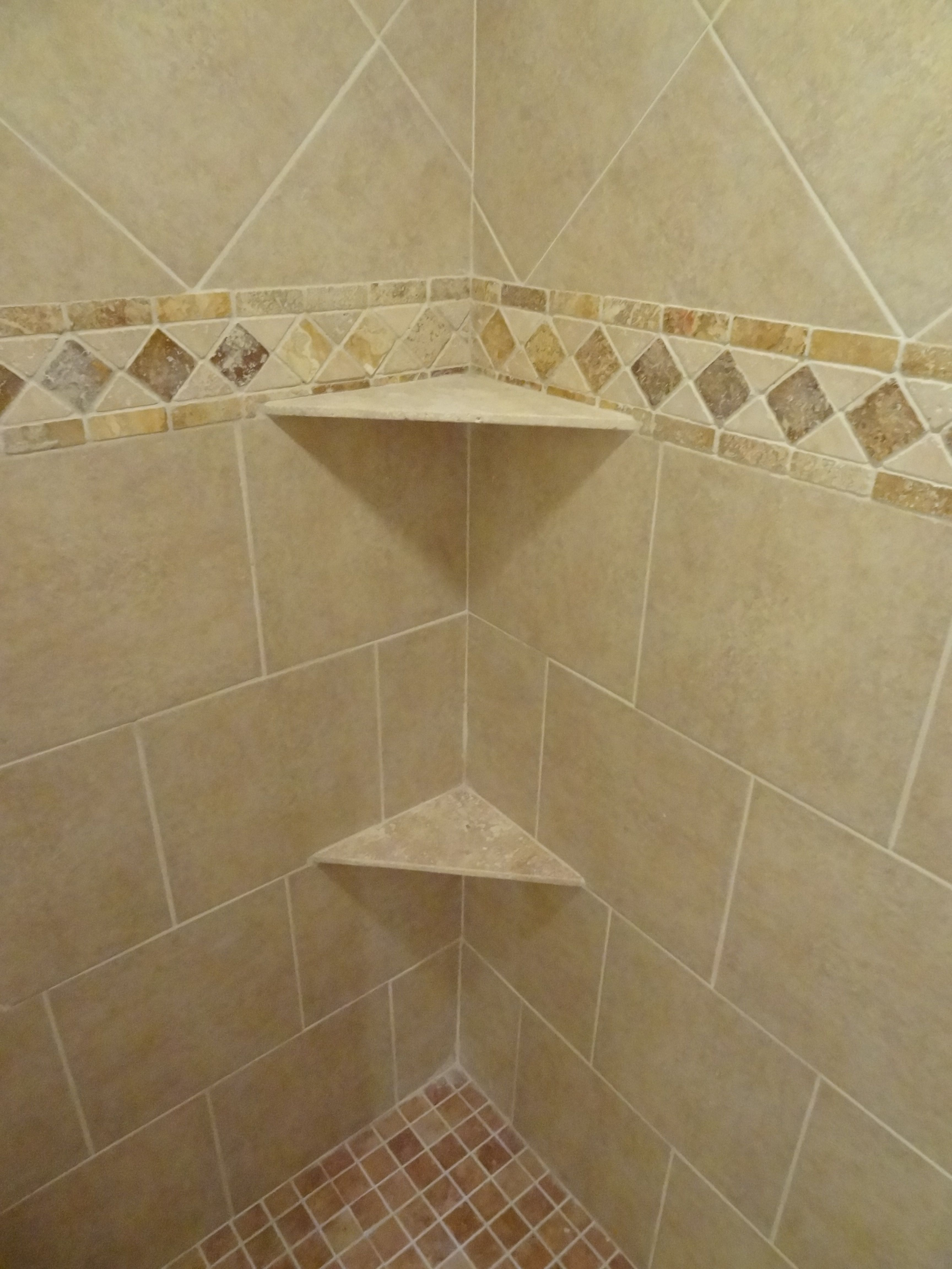 our own ceramic shower wall and floor tile border detail