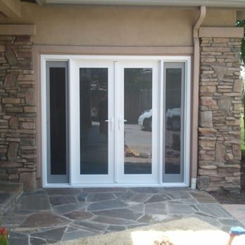Garage Door Converted Into French Door With Two Side