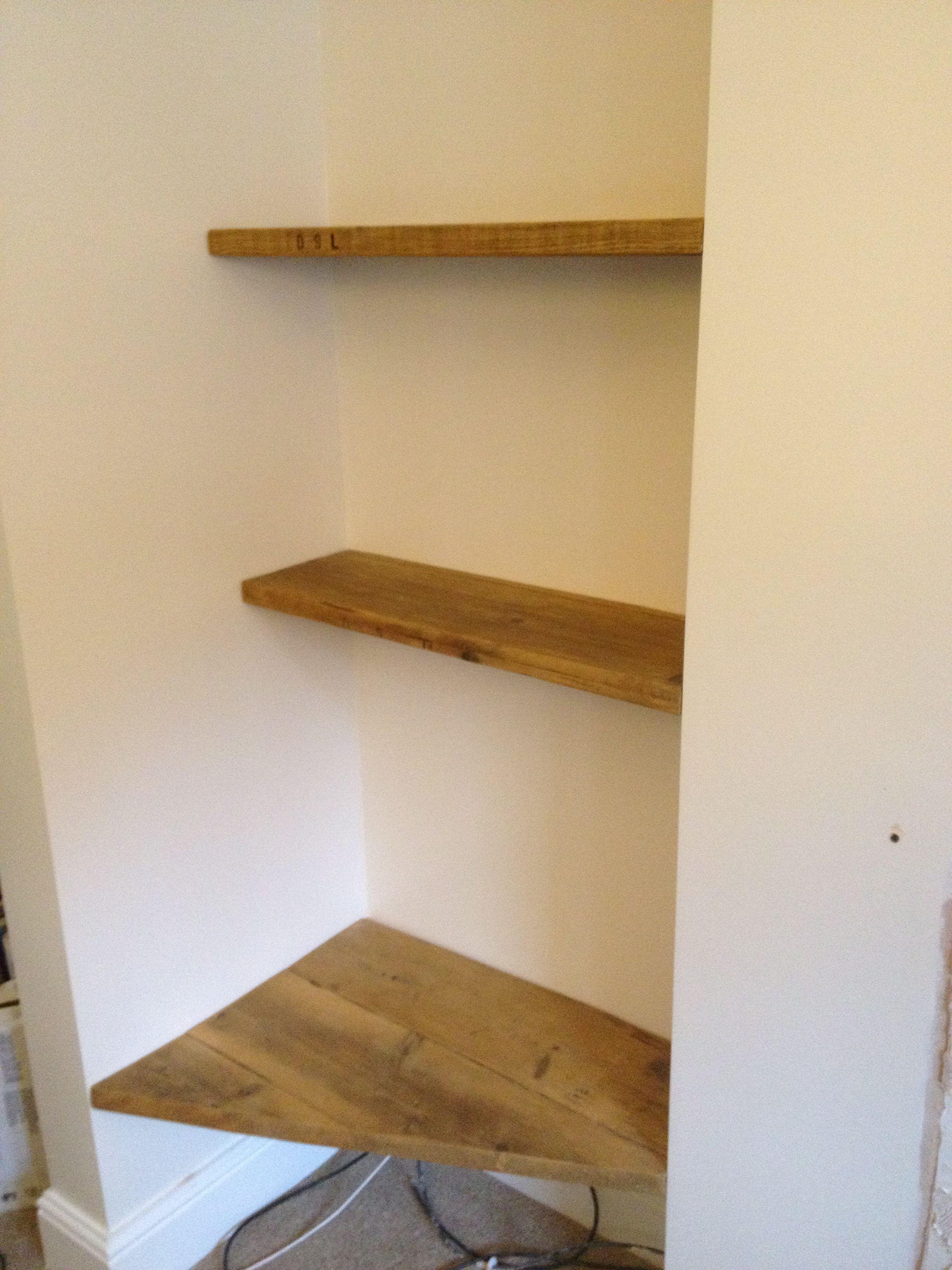 tv corner shelf and book shelves made from reclaimed scaffolding