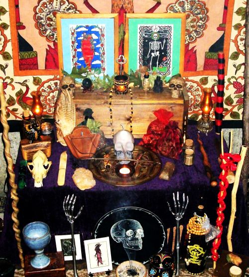 My personal working altar/shrine. Focusing on traditional witchcraft and sorcerous currents of praxis. Here you see various implements of my arte. spirit bottles, wands, symbols and sigils of magic, along with two pieces of artwork I drew personally for Lilith and Qayin.
