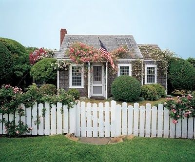 """A white picket fence has become a symbol of """"the American dream"""" of owning a nice house in which to raise your family and live """"happily ever after.""""  (The 10 of Pentacles)"""