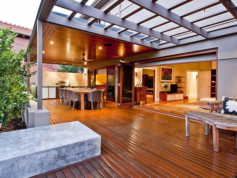 Indoor-outdoor outdoor living design with verandah & decorative ...