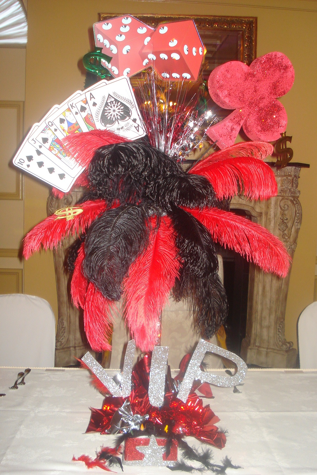 Las vegas centerpieces feathers playing cards dice for Las vegas themed weddings