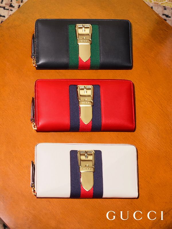 086ee666875286 A trio of Gucci Sylvie wallets, featuring the House Web stripe and gold  hardware from Pre-Fall 2017 by Alessandro Michele.