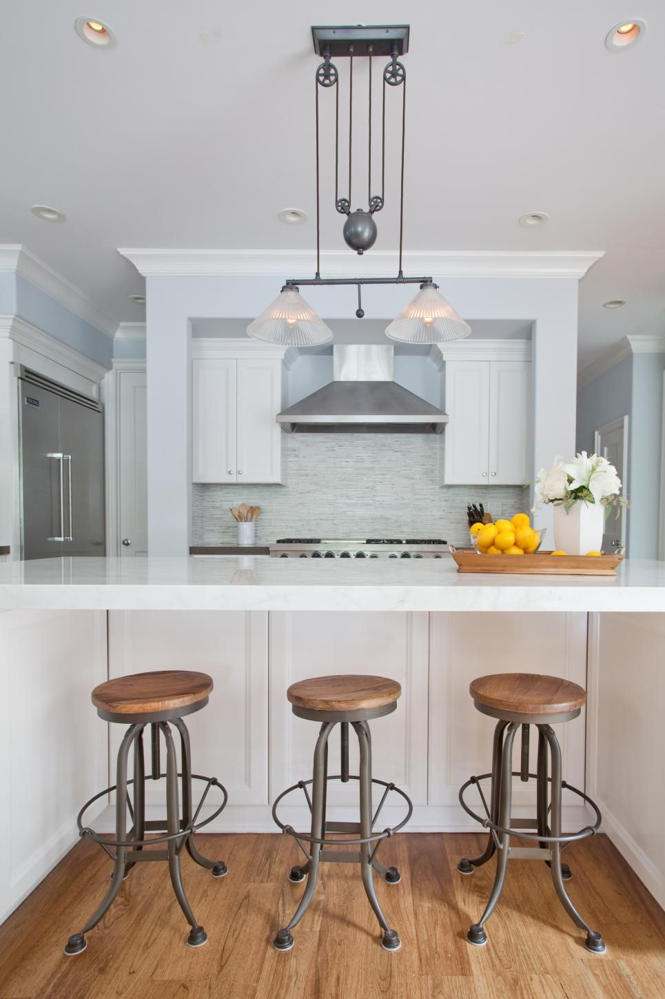 A soft blue wall color keeps this kitchen space looking light and ...