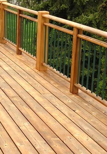 Traditional Red Cedar Paired With Metal Balusters And A Unique