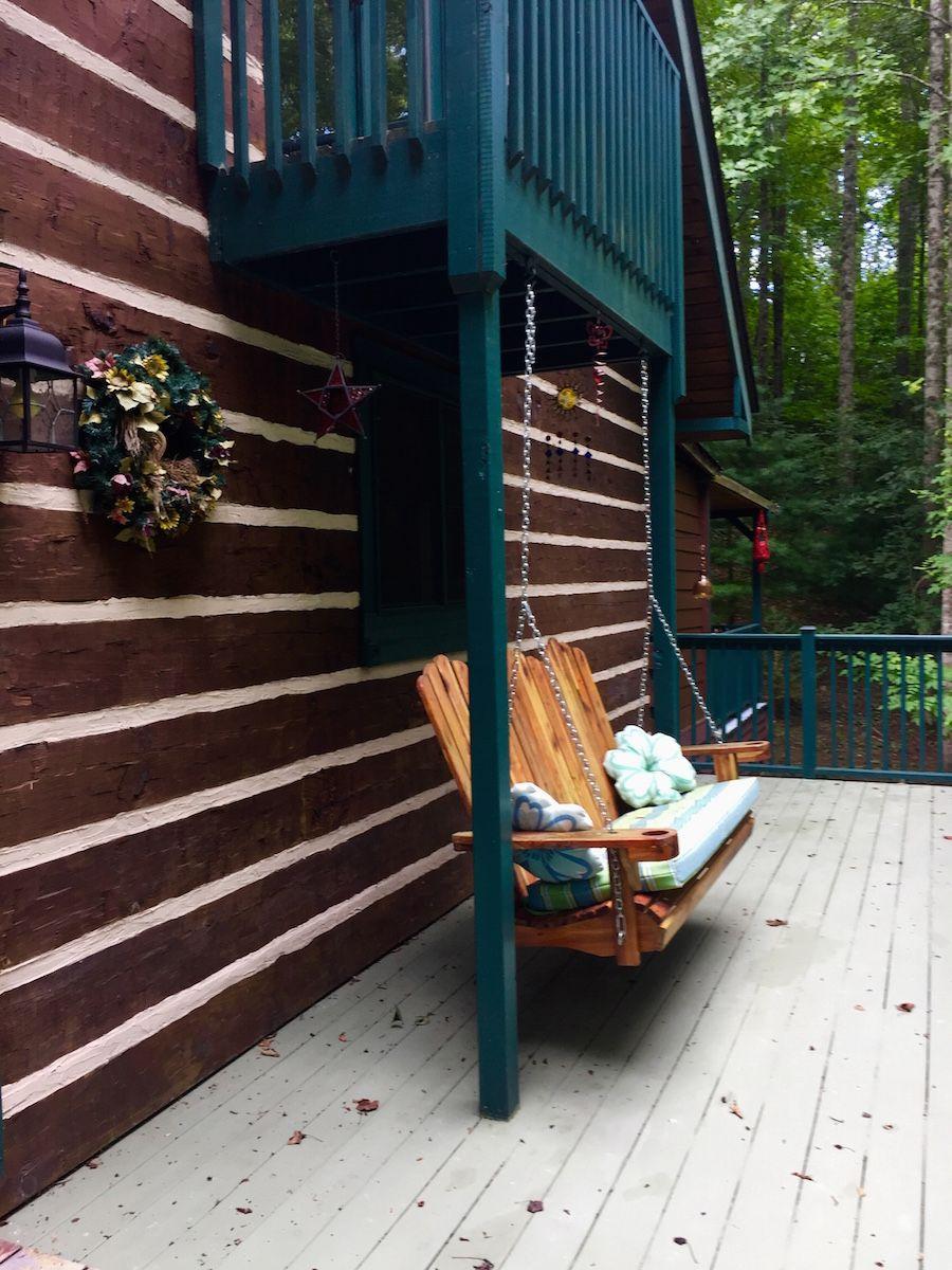 Porch of Southland Log home hand hewn Applachian pine logs