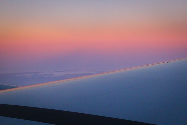 Sunrise from airplane window, approaching New Zealand.