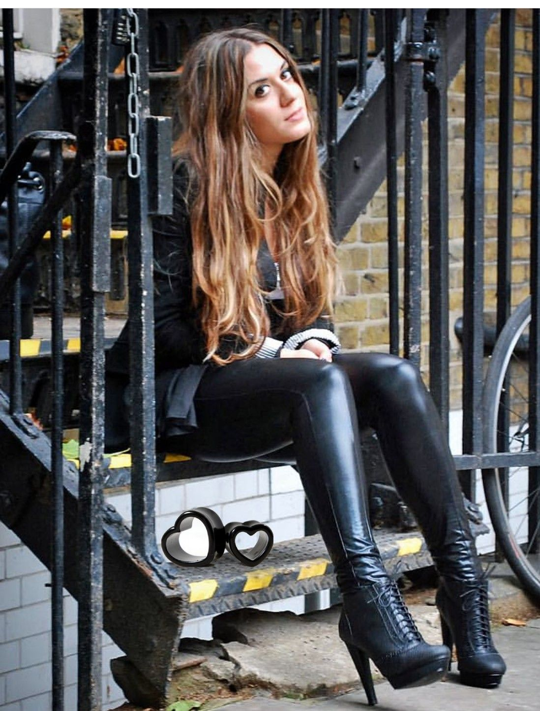 Cute brunette in black leather leggings and ankle boots