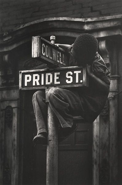 W. Eugene Smith … Pride Street, Pittsburgh … 1955 … Boy Hanging on Colwell & Pride St. Sign …