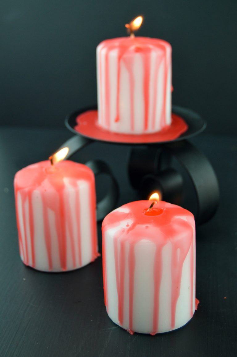 DIY a set of Halloween bleeding candles by following this easy home - How To Make Halloween Decorations