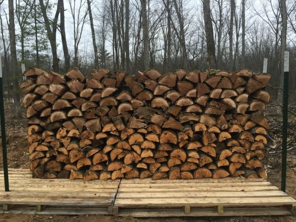 Stacking firewood on pallets is a cheap, easy way to stack your