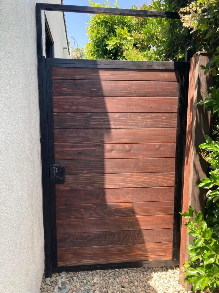Pedestrian Gate Iron Frame And Wood Inserts Electronic Lock In 2020 Wood Gate Solar Powered Gate Opener Custom Gates