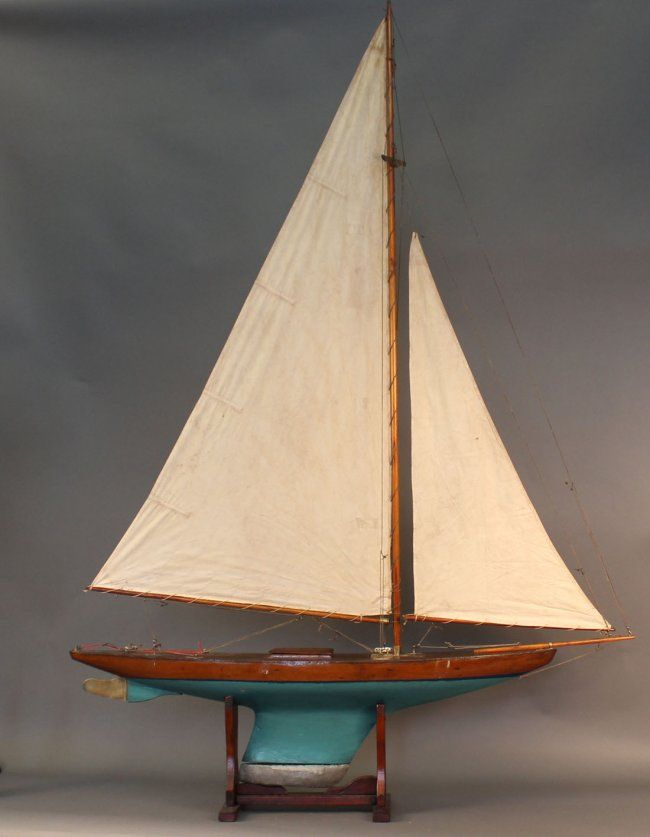 Vintage pond yacht rigged Marconi style with brass fittings and
