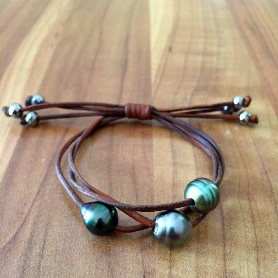 Photo of Tahitian Pearls on Australian leather. One of a kind pearls trio bracelet for women, adjustable size