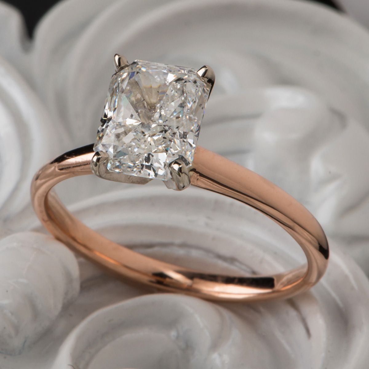 A beautiful radiant cut diamond sparkles brightly in this sweet and