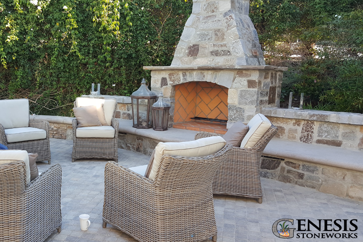 A Custom Outdoor Fireplace Seating Wall And Paver Patio Create