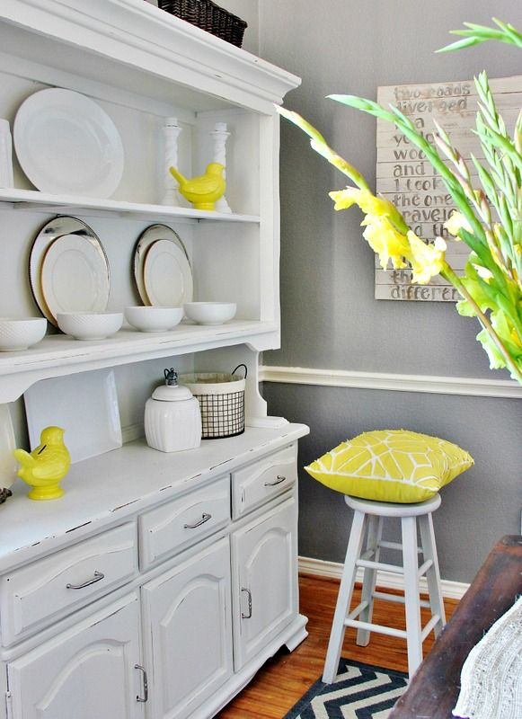 Gray dining room with yellow accents for the home for Grey and yellow dining room ideas