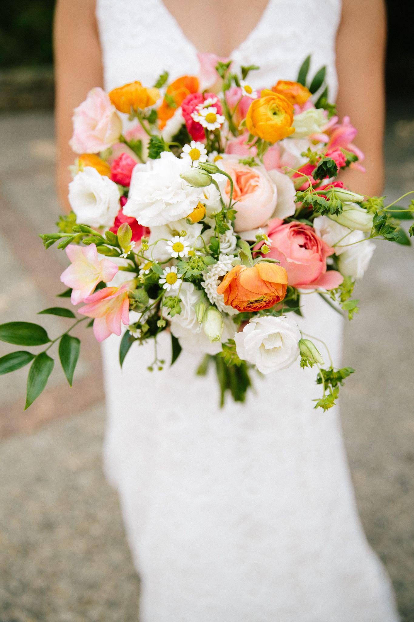 Katie carried orange ranunculus white carnations pink