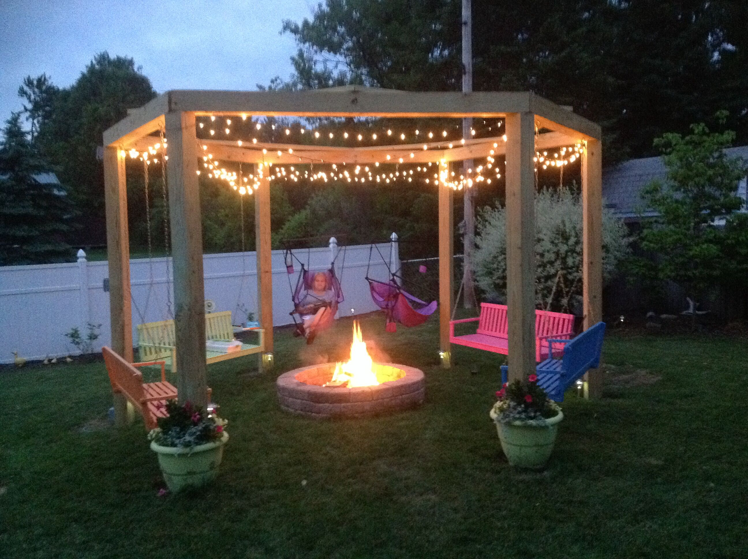 We love our fire pit swing gardening pinterest for Porch fire pit ideas