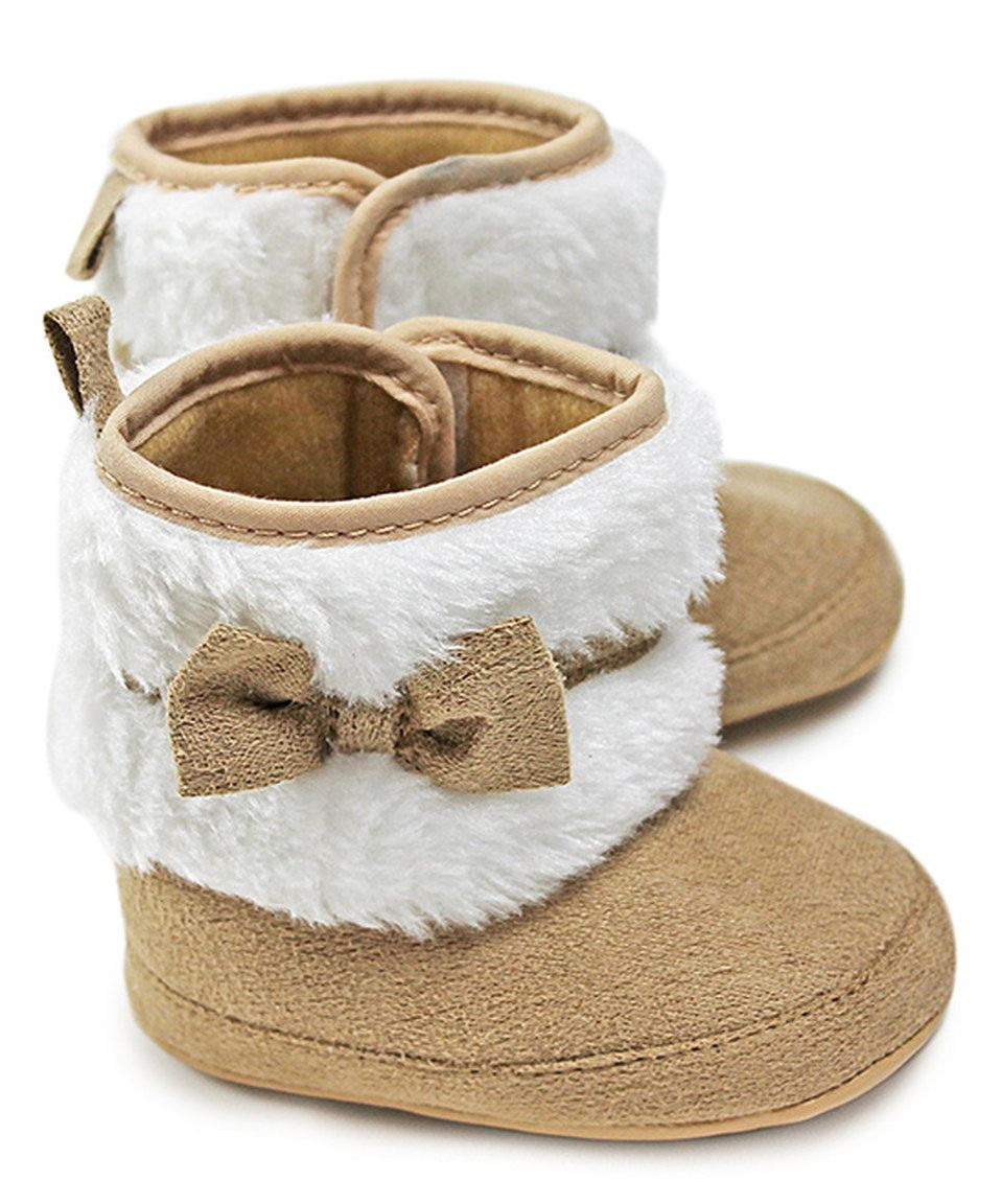 This Z by Yoon Cream Faux Fur Bow Booties by Z by Yoon is perfect! #zulilyfinds