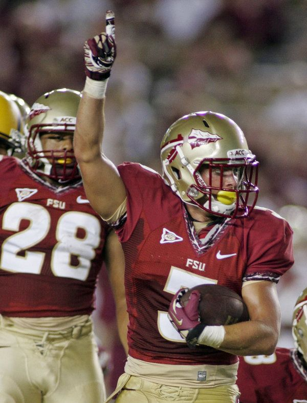 Florida State safety Justin Bright (3) celebrates his fumble recovery in  the fourth quarter. (AP Photo Phil Sears) 043addc83