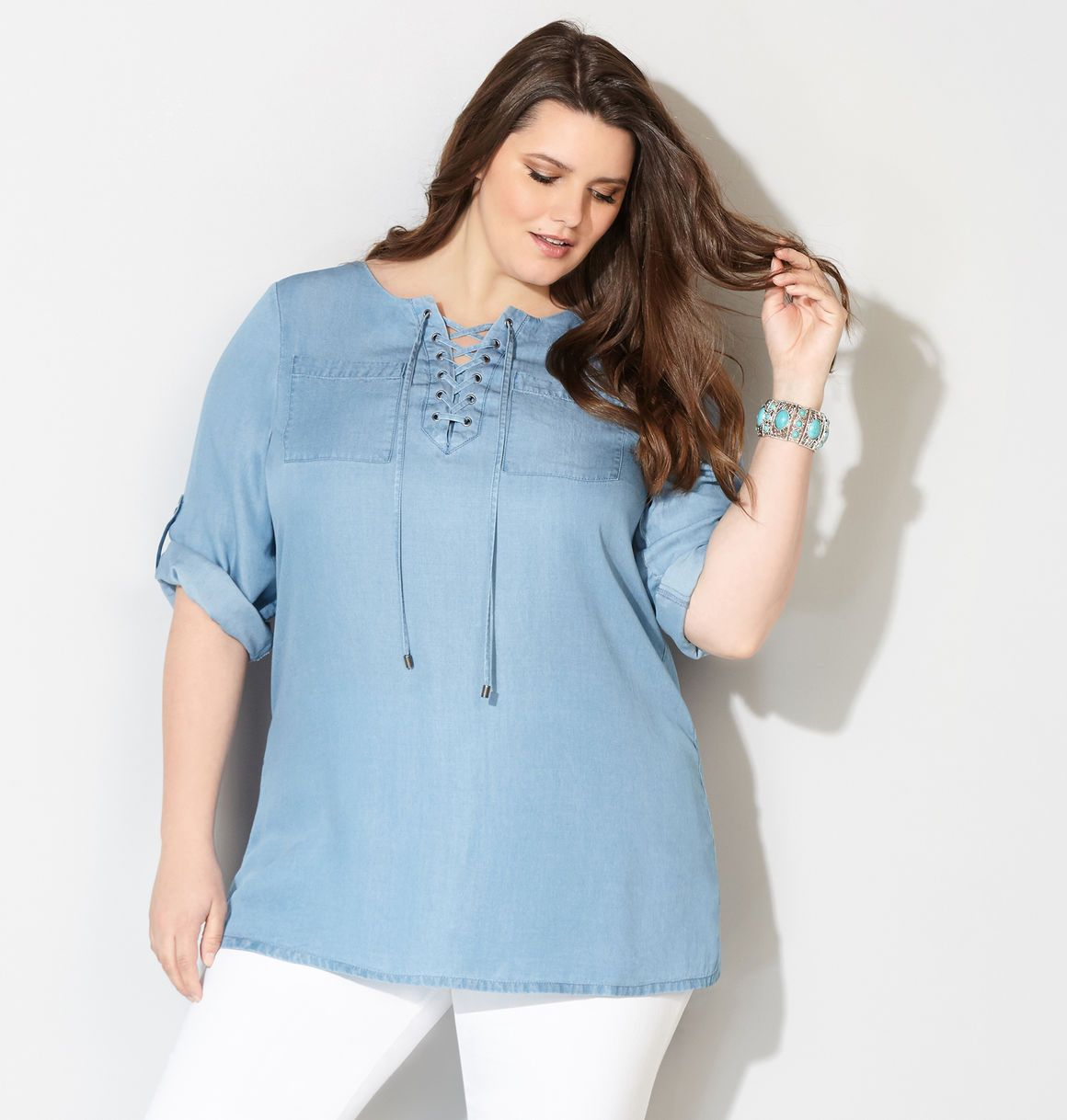 df74047f340 Shop long, flattering tunics in sizes 14-32 like the plus size Lace-Up  Denim Tunic available online at avenue.com. Avenue Store