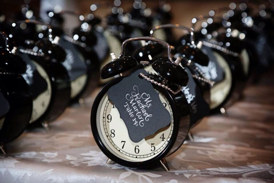 Seating cards attached to cool lil' clocks for a New Year