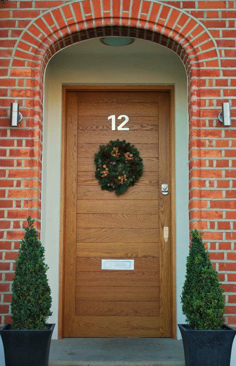 Modern wooden door by the London Door Company with festive ...