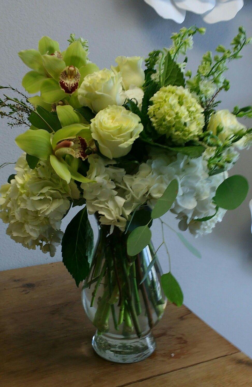 Fresh floral arrangement using green and white hydrangeas