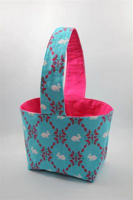 fabric easter basket. This turned out really cute! The only change I would make for next time is to use a less heavyweight interfacing. I got the stiffest stuff I could find, just like the tutorial suggests, and it was a PAIN to sew through. The bag is definitely sturdy, though! :)