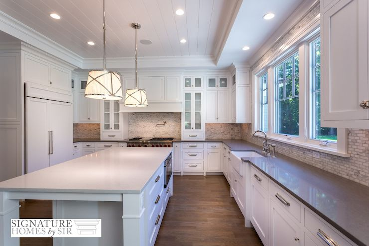 Long Kitchen Boasts White Shaker Cabinets Adorned With