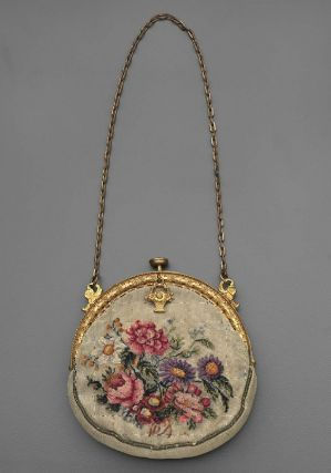Woman's purse~~  Round petit point embroidered purse, gold metal frame with hanging basket charm, gold metal chain, pink silk plain weave lining. Purse contains a small pink silk change purse and a small mirror, tarnished.   Gift of Susan G. and Harry Kohn, Jr. to the Museum of Fine Arts Boston, September 19, 2007.  American, early 20th century  Linen plain weave embroidered with silk, brass frame.