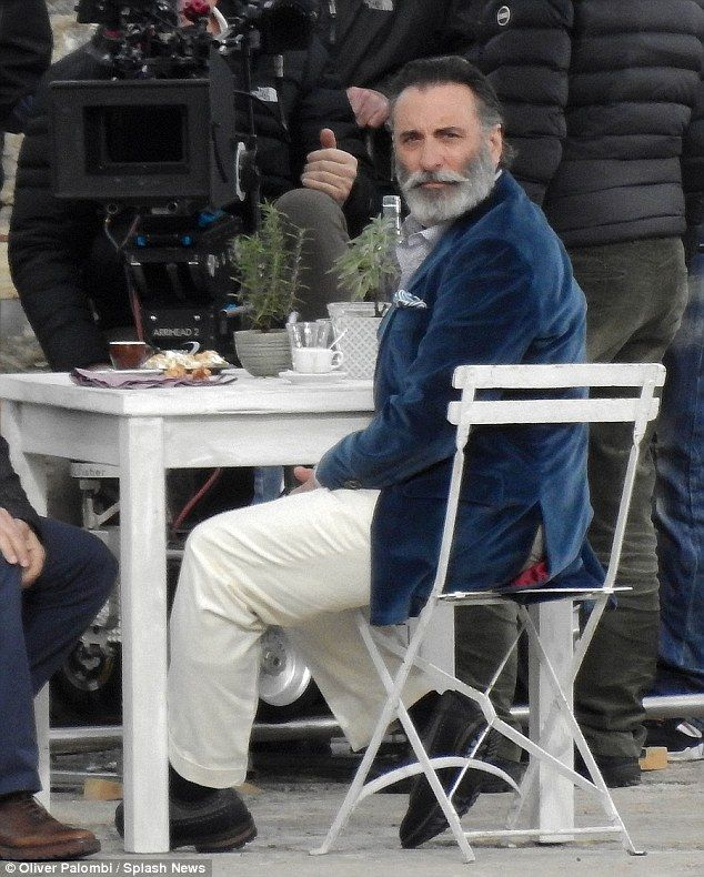 New facial hair: Andy Garcia displays a new bushy beard and carefully crafted old fashioned moustache as he filmed in Sicily on Saturday
