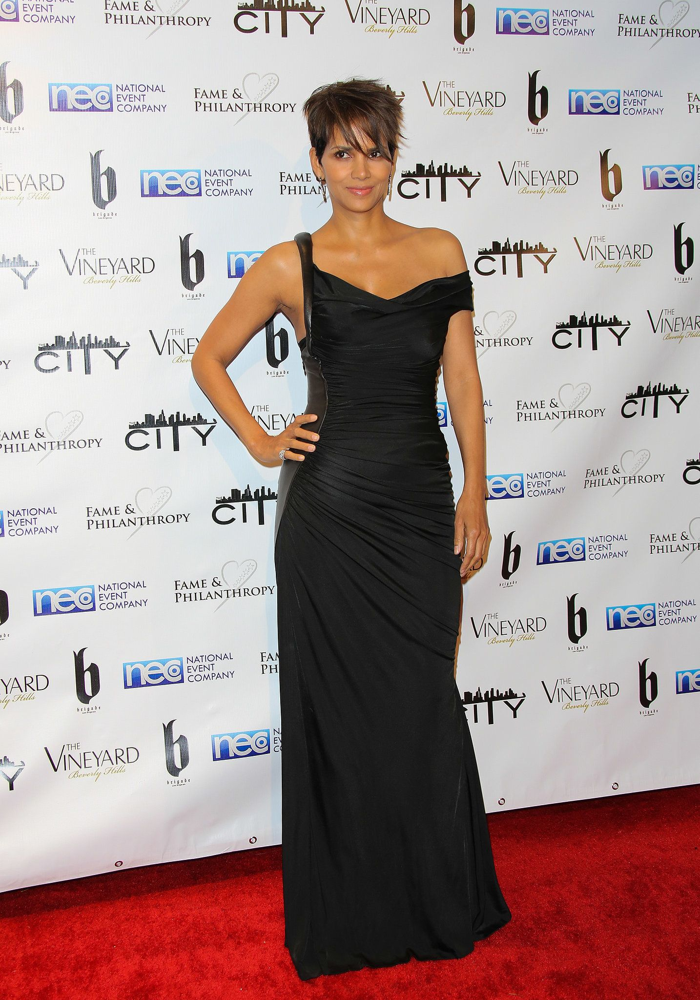 Halle Berry chose a black vintage Versace dress for the Fame and Philanthropy Post-Oscar Party. She rounded the look out with Stuart Weitzman heels.