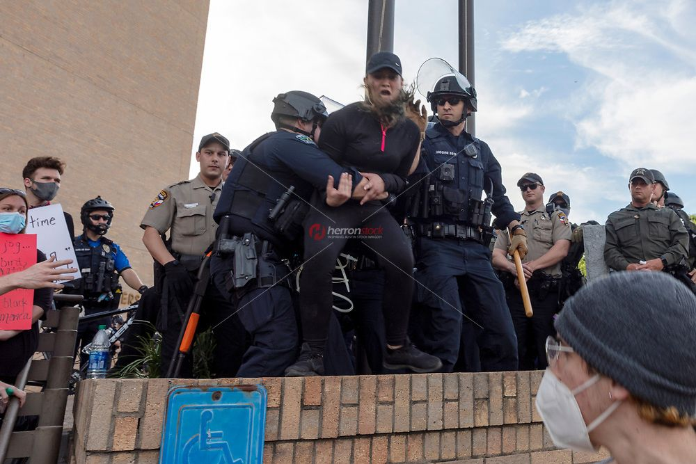 Austin Texas May 30 Austin Police Officers Grab A Terrified Female Protester Into Custody At Th Black Lives Matter Protest Austin Police Black Lives Matter