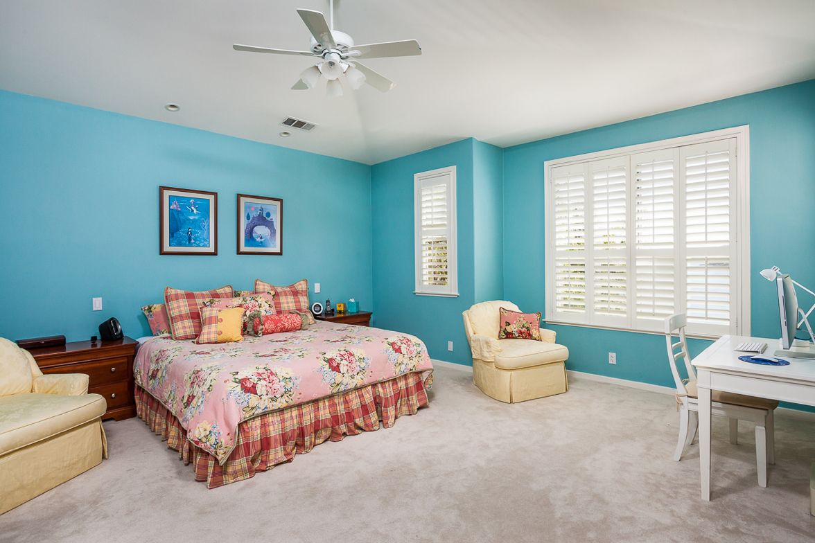 Private master suite has a sprawling floor plan with high
