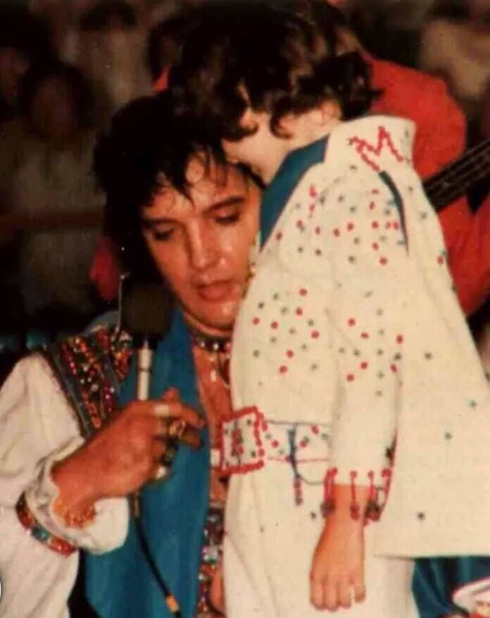 ♡♥Elvis Presley wearing many rings entertains a young child♥♡