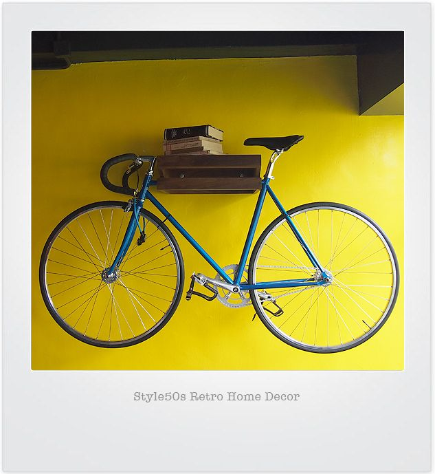 K11 Bike Rack Perfect Wall-Mounted Solid wood Bike Rack, your bike rack could be an art piece, carrying your books & bicycle together in the best method.  Elegant and functional, the OneUp is the perfect bicycle storage solution for apartments and small spaces.