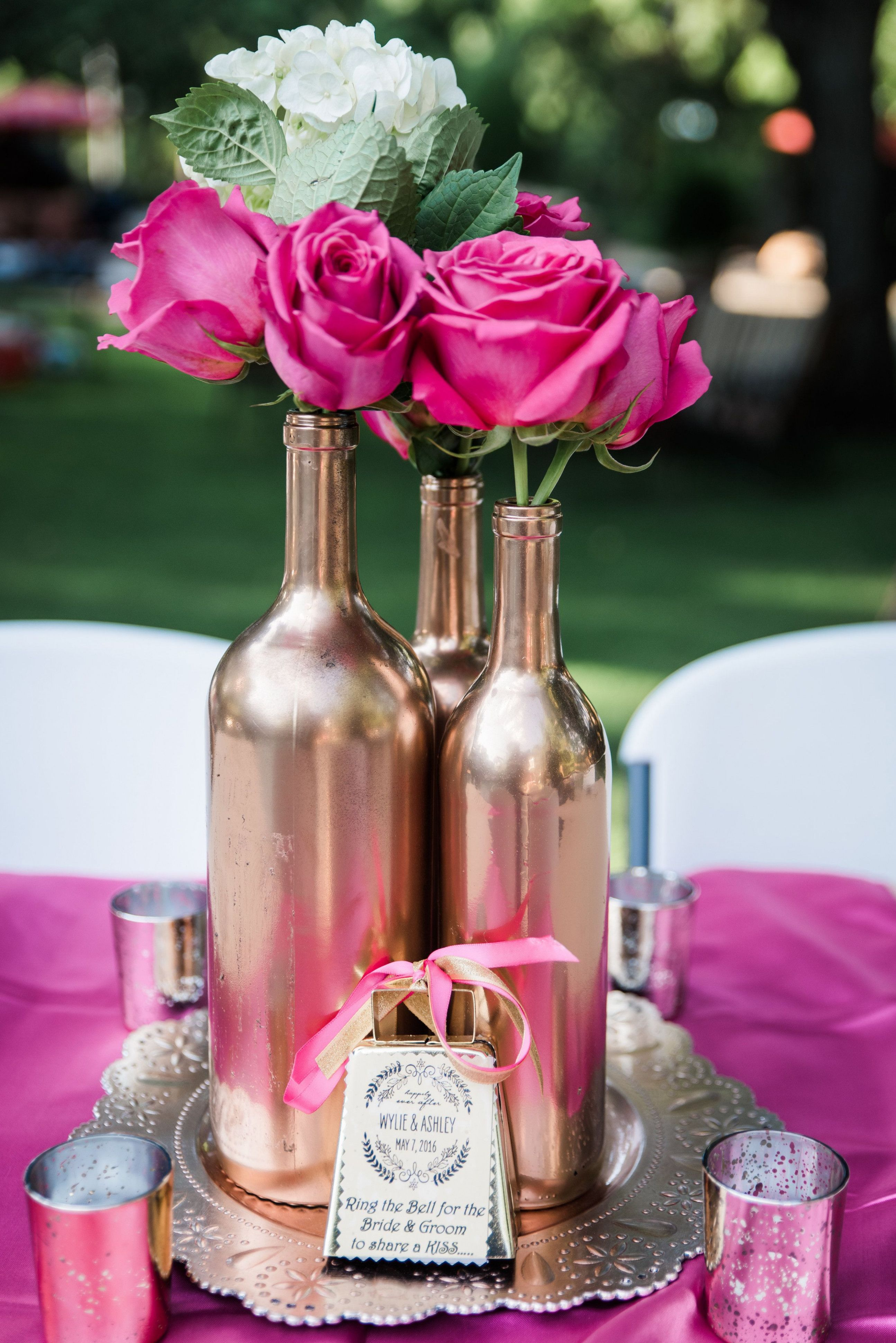 rose gold wedding theme centerpieces - hot pink roses and