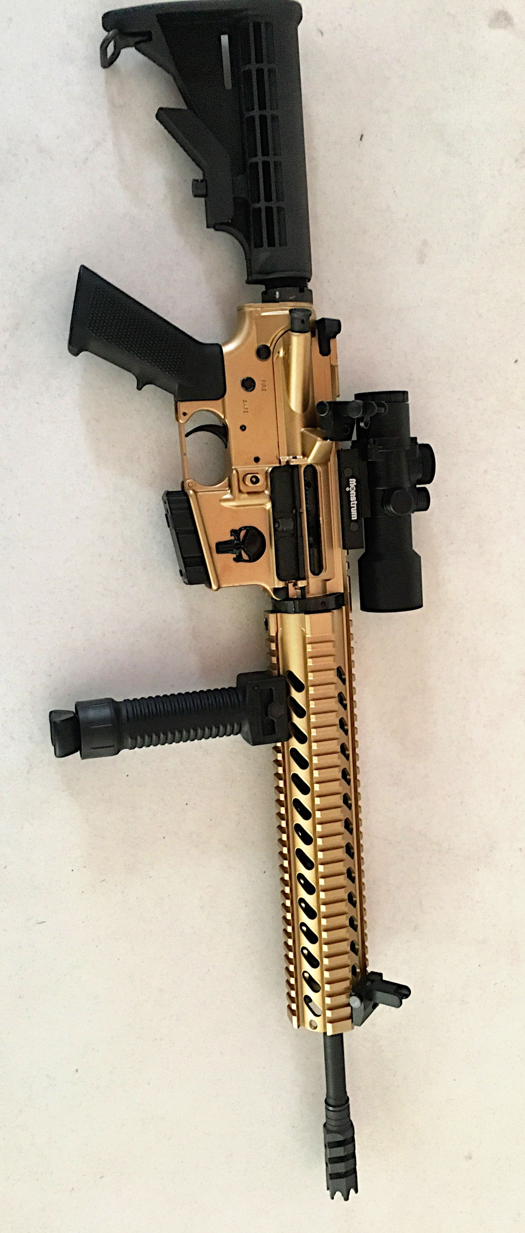 Ar 15 done in mars gold with 45 degree sights and a monstrum scope