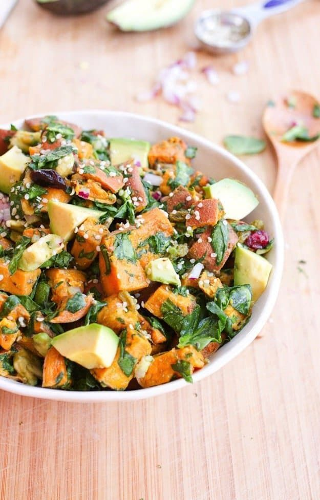 Roasted Sweet Potato Salad made with chopped spinach, creamy avocado chunks, red onion and dried cranberries. Light, refreshing and perfect forspring picnics and summer BBQs!