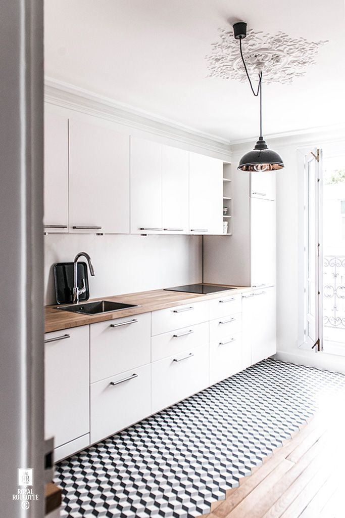Great solution for a chandelier with a J-box in a less than desirable location. | Love this graphic, minimalist kitchen design!
