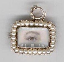 Combination pin/pendant lover's eye surrounded by pearls and with removable pearl bale, circa 1820.  Back compartment with blond hair and inscribed: Anne Dodsworth Died Jan 13, 1876 Aged 75.