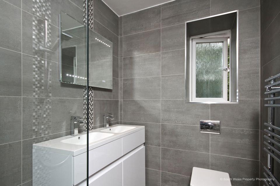 grey tiled bathroom  fully tiled bathroom ensuite