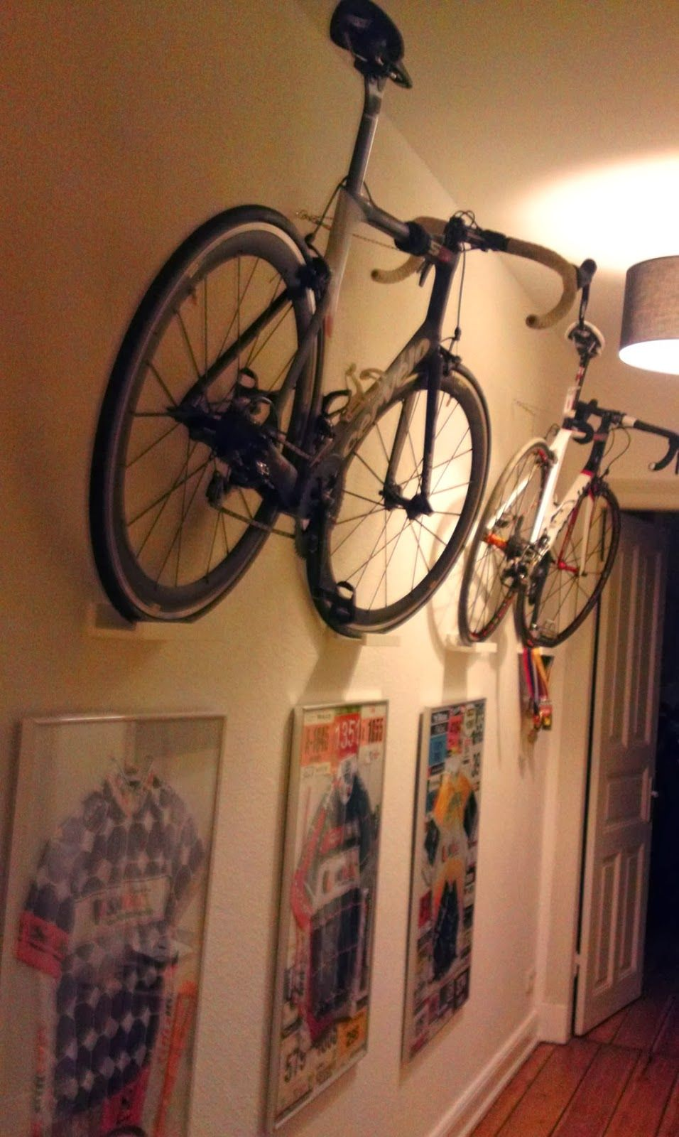 put your roadbikes on the wall simple method using ikea parts interior design apartment. Black Bedroom Furniture Sets. Home Design Ideas