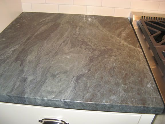 the countertops are a granite called ocean green from gerrity