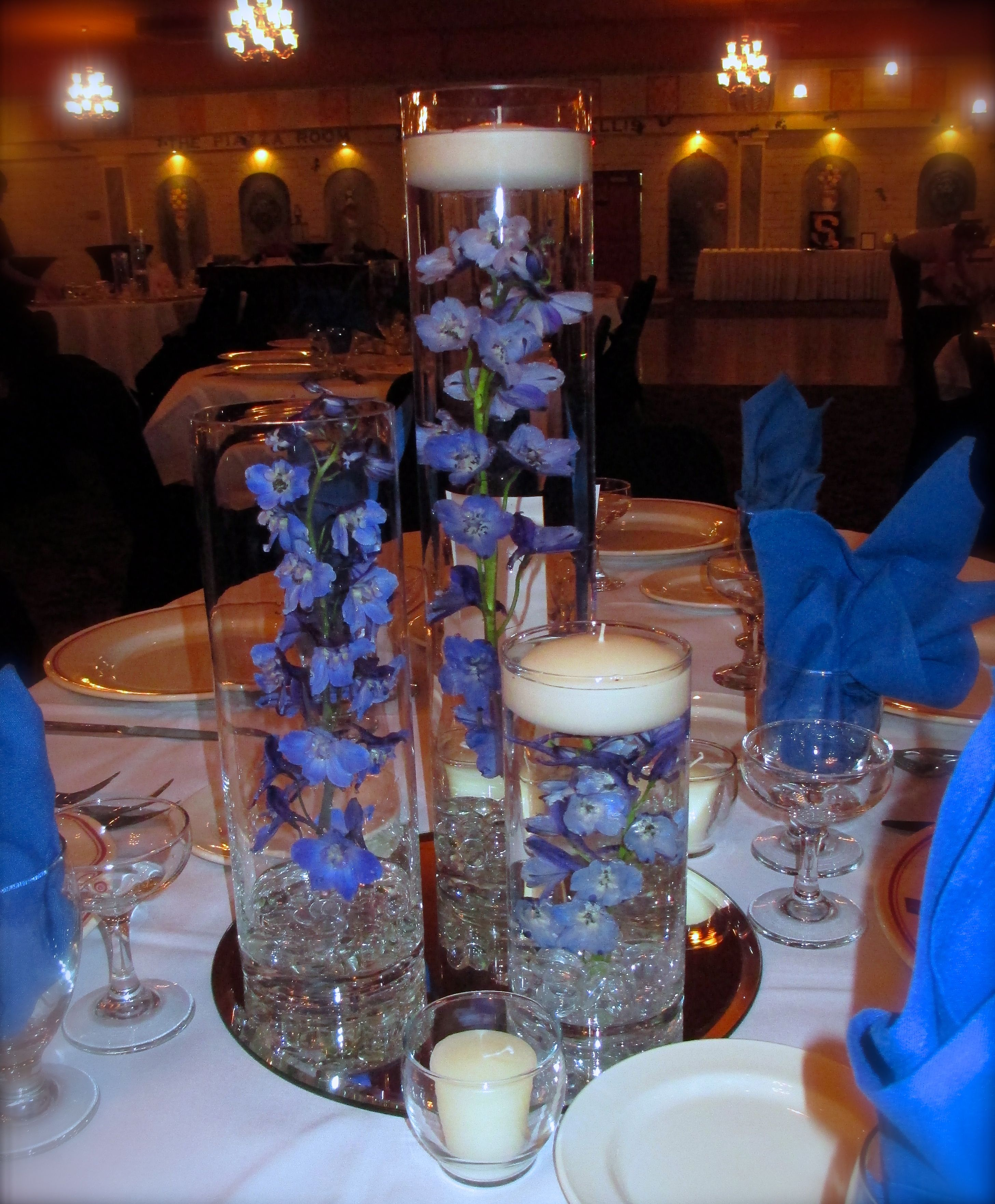 Trio vase with blue delphinium our floating candles